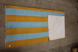 A vibrant blue and gold material hand ma