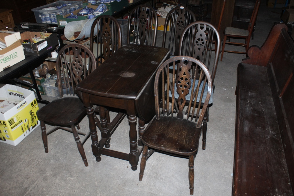 A set of four stained elm seated wheel b - Image 2 of 2