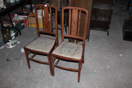 A pair of Edwardian string inlaid mahoga