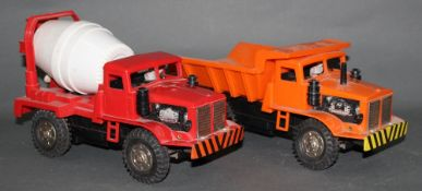 Two plastic Marx trucks,