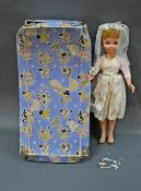 A 1960's boxed Pedigree Teenage Bride doll, measuring 51 cm (20 ins) tall,