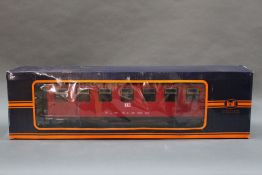 "Two ""Train"" Newqida G Gauge coaches with boxes"