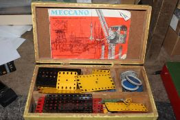 Two wooden painted chests containing Meccano.