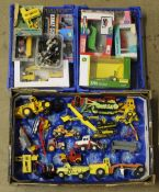 A group lot of boxed and unboxed diecast and plastic model construction vehicles, by John Deere,