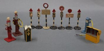 A group lot of Dinky diecast roadside and other accessories, comprising road signs,
