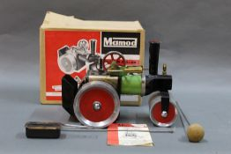 A boxed 1960's Mamod SR1 steam roller with burner and steering rod.