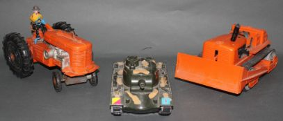 A group of three plastic Marx toys, comprising a battery operated Cap Firing Tank,