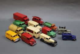 A group lot of Dinky diecast trucks and vans, comprising Slumberland Mattress guy van,