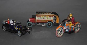 Three tin toys,