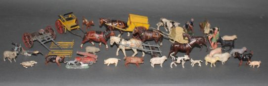 A collection of Britain's lead farm animals, horses, ploughs and figures.