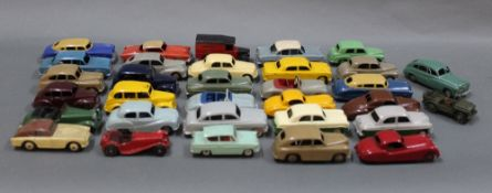 A group of 31 Dinky diecast model vehicles to include taxis