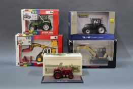 A group lot of boxed agricultural diecast model vehicle, comprising Britain's,