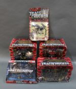 A group lot of Hasbro Transformers toys, comprising a Revenge of the Fallen Master of Metallikato,