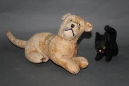 Two early to mid 20th century and wood wool filled cat soft toys, the largest measuring 45 cm long,