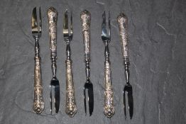 A set of six Elizabeth II silver handled kings pattern pastry forks, the silver handles by H B,