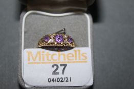 An 18ct gold amethyst and diamond ring of Victorian style,