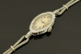 An early 20th century platinum and diamond set cocktail wristwatch,