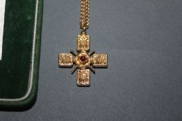 A British museum gilt metal and purple coloured paste, reproduction crucifix and chain,