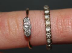A gold coloured metal and white stone full eternity ring,