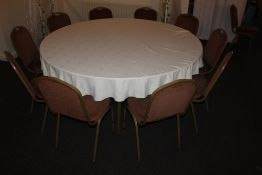 A large circular hotel dining table, wit
