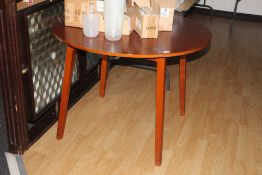 Two modern stained circular dining table