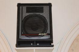 A pair of large McCoy sound system speak