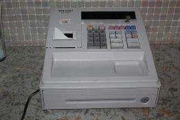 A Sharp XE-A107 electronic cash register