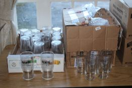 A box of unbranded pint glasses, 48 in t