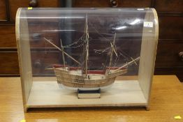 A cased model merchant ship, scale 1:72, case dimensions 53 cm wide,