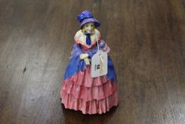 Royal Doulton figurine of a Victorian lady (broken and glued back together)