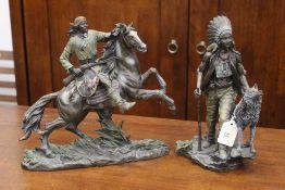 Two Native American figural ornaments,