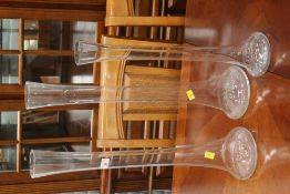 Three tall glass vases,