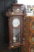 An inlaid mahogany Vienna style wall clock with three train movement