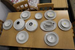 A Royal Doulton Morning Star design dinner service, tureens, dinner plates, sauce boat, bowl,