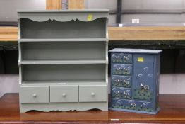 A miniature wall shelf unit with three small drawers, height 46 cm, width 40 cm, depth 13 cm,