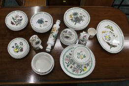 A large collection of Portmeirion Botanic Garden tea plates, dinner plates, bowls, rolling pin,