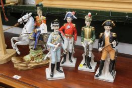 Five figurines in 19th century military uniforms, one mounted, horseman height 31 cm,