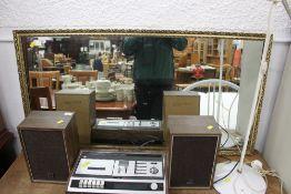 A gilt framed rectangular mirror