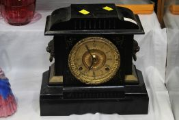 Late 19th/early 20 the century mantle clock with black metal body and gilt face