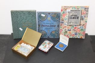 Three small stamp albums and a quantity of loose stamps,