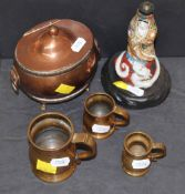 An early 19th century copper oval lidded two-handled tea caddy, 14 cm high, (feet re-soldered),