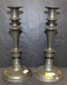 A pair of pewter pillar candlesticks, 25.