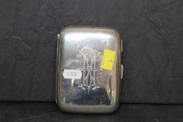 An Edward VII silver cigar case the curved body with bold engraved armorial to front, 12.