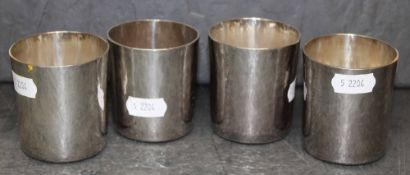 A set of four Britannia standard toasting cups of simple planished design by RNRG each 5.
