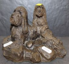 A Patsi Ann resin figure of two dogs, 13 cm high, No.