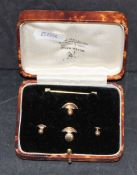 Four 9ct gold shirt studs, combined weight 3 grams,