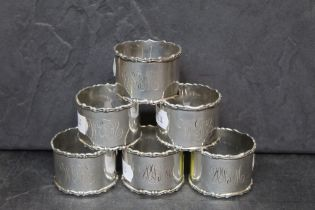 A set of 6 Edward VII silver napkin or serviette rings by Sydney & Co of plain design with cast