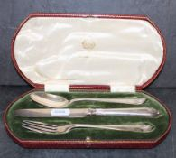 George V silver three piece christening set by Elkington with curved reeded terminals,