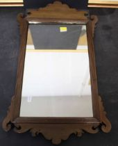 A George II mahogany rectangular wall mirror with shaped cresting and apron,