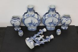 A pair of late 19th century delft blue and white pottery moon flasks,